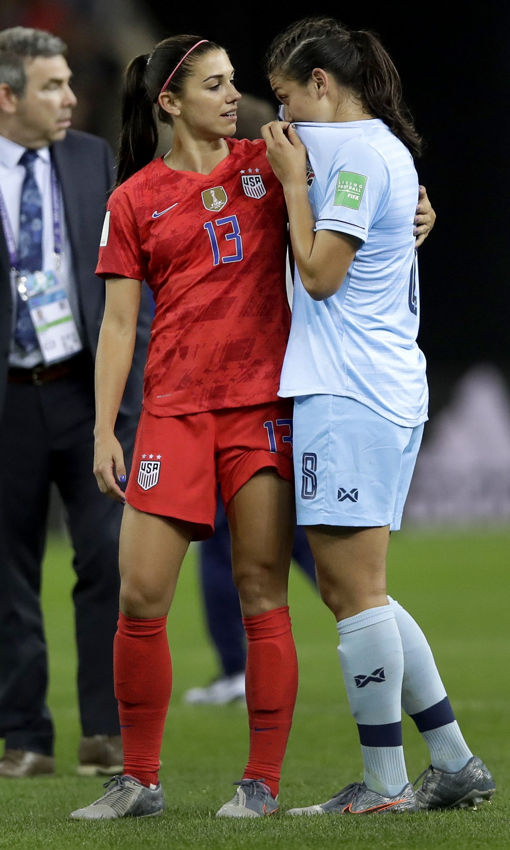 United States' Alex Morgan, left, comforts Thailand's Miranda Nild, right, after the Women's World Cup Group F soccer match between United States and