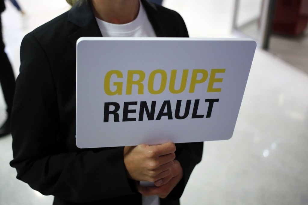 A hostess holds a sign of French automaker Renault Group to show the way for the Renault shareholders general meeting in Paris, France, Wednesday, Jun