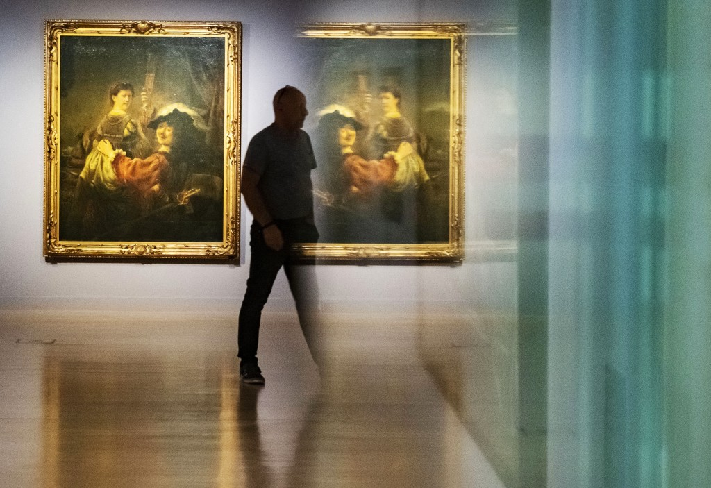 The painting 'Rembrandt with Saskia as the prodigal son' (c.1635) by Rembrandt is reflected in a showcase during a press preview of the exhibition 'Re