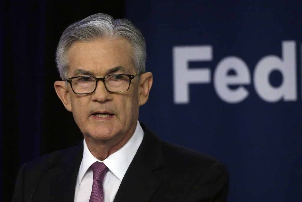 FILE - In this June 4, 2019, file photo Federal Reserve Chairman Jerome Powell speaks at a conference involving its review of its interest-rate policy