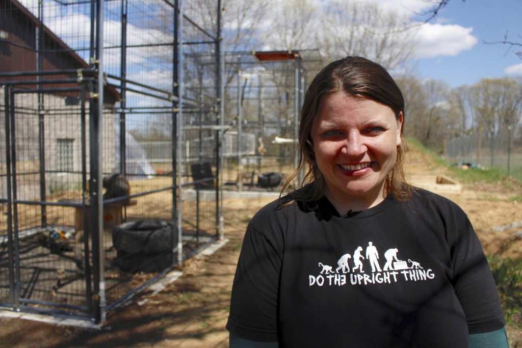In this May 13, 2019, photo, Amy Kerwin stands outside the outdoor enclosures at Primates Inc., in Westfield, Wis. Kerwin started the sanctuary, which