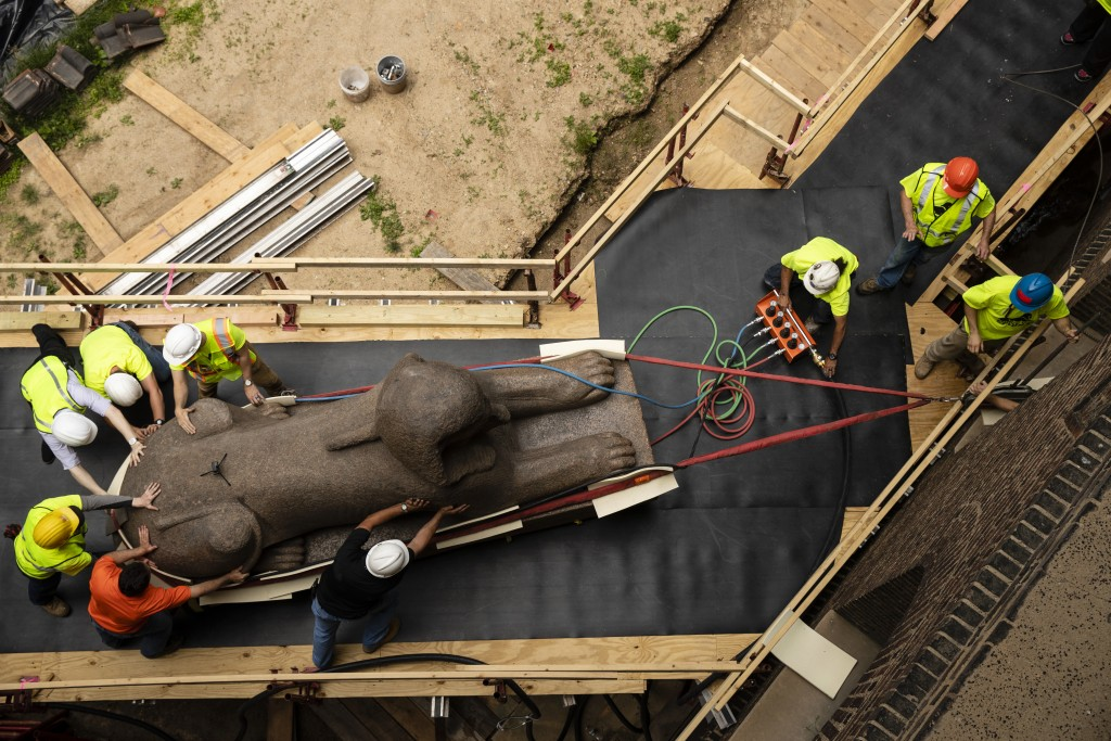 Workers move a 25,000-pound Sphinx of Ramses II at the Penn Museum in Philadelphia, Wednesday, June 12, 2019. The 3,000-year-old sphinx is being reloc