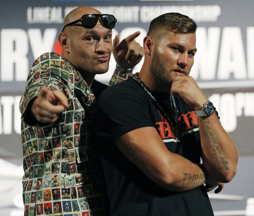 Tyson Fury, left, of England, and Tom Schwarz, of Germany, pose during a news conference for their upcoming fight Wednesday, June 12, 2019, in Las Veg...