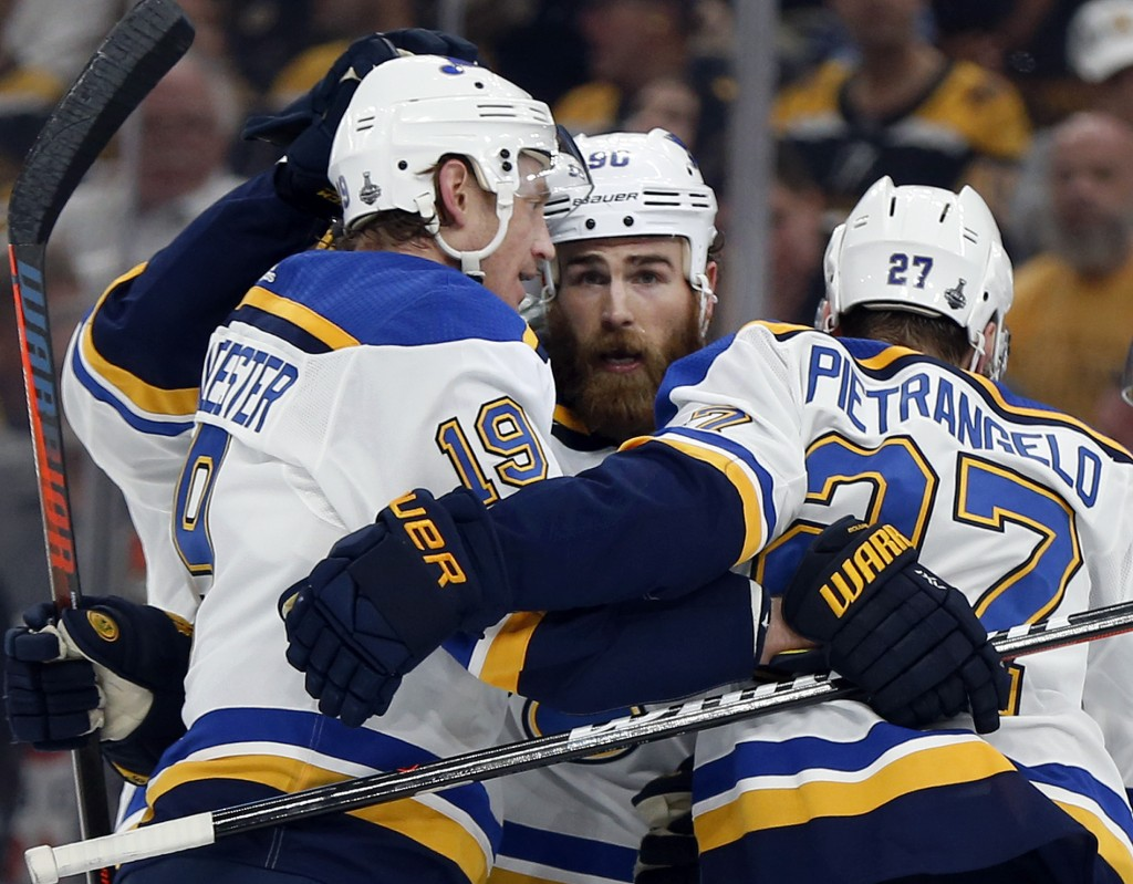 St. Louis Blues' Ryan O'Reilly, center, celebrates his goal with teammates Jay Bouwmeester, left, and Alex Pietrangelo, right. during the first period...