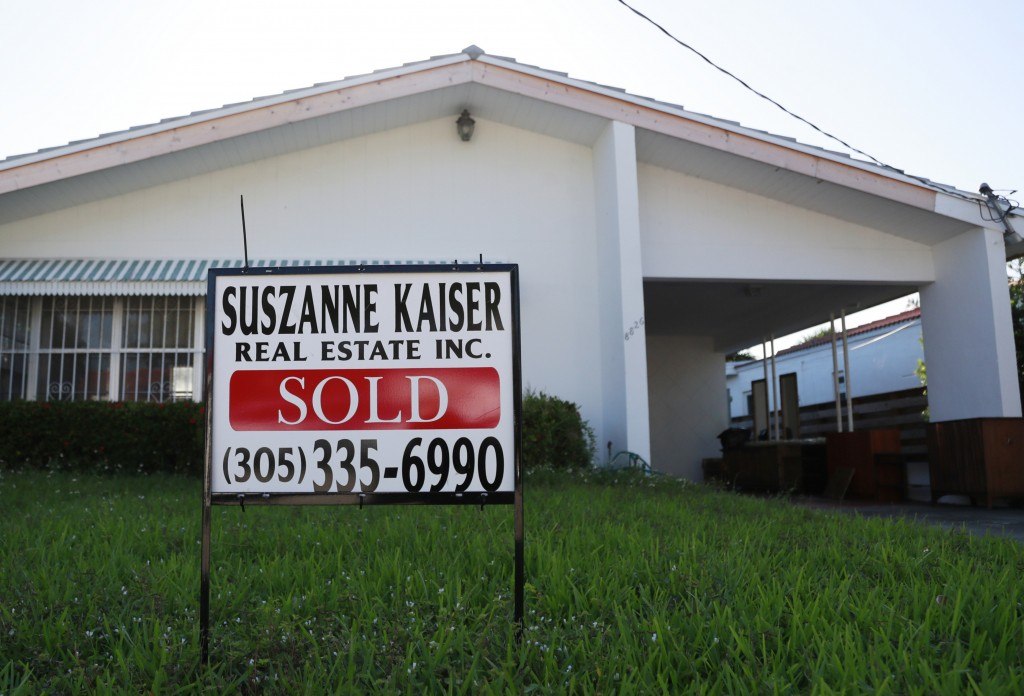 FILE - In this April 12, 2019, file photo, a sold sign is shown in front of a home in Surfside, Fla. On Thursday, June 13, Freddie Mac reports on this...