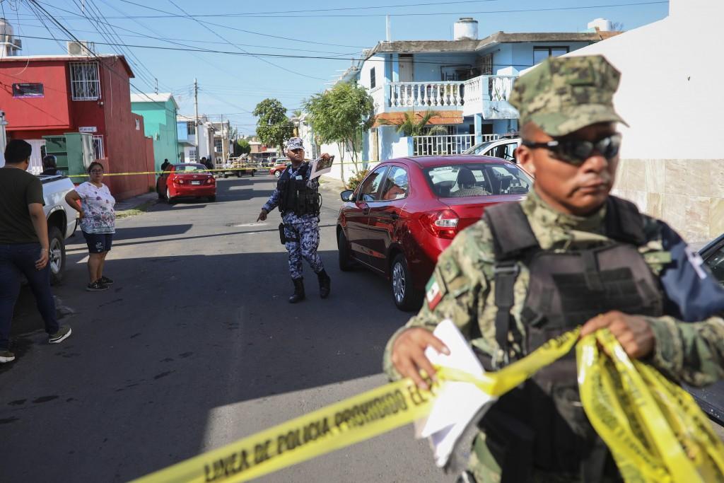 Authorities cordon off the area where journalist Marcos Miranda was kidnapped, in Boca del Rio, Veracruz state, Mexico, Wednesday, June 12, 2019. Mira...