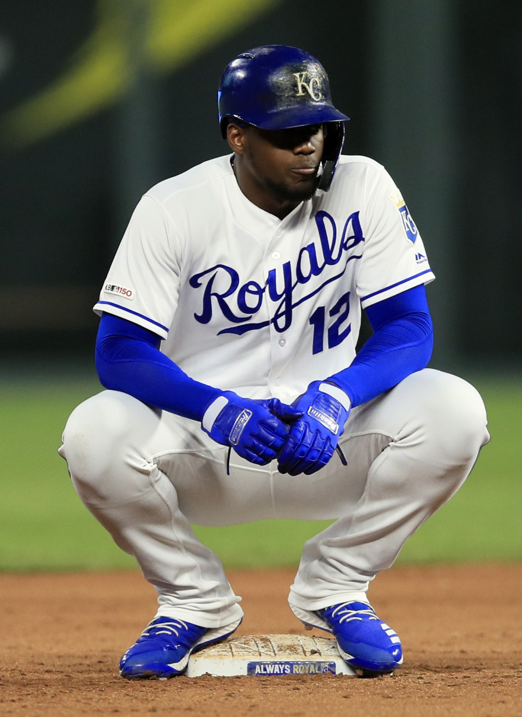 Kansas City Royals designated hitter Jorge Soler waits out a mound meeting while at second base during the fifth inning of the team's baseball game ag...