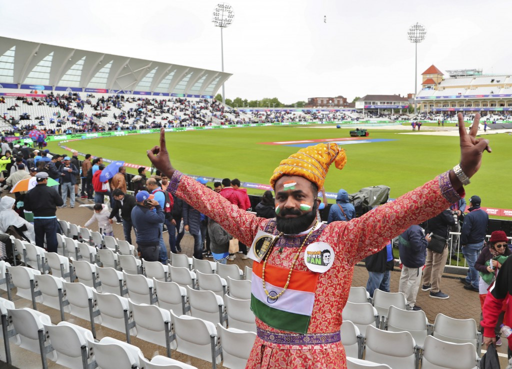 An Indian fan flashes victory sign as rain delayed start of the Cricket World Cup match between India and New Zealand at Trent Bridge in Nottingham, E