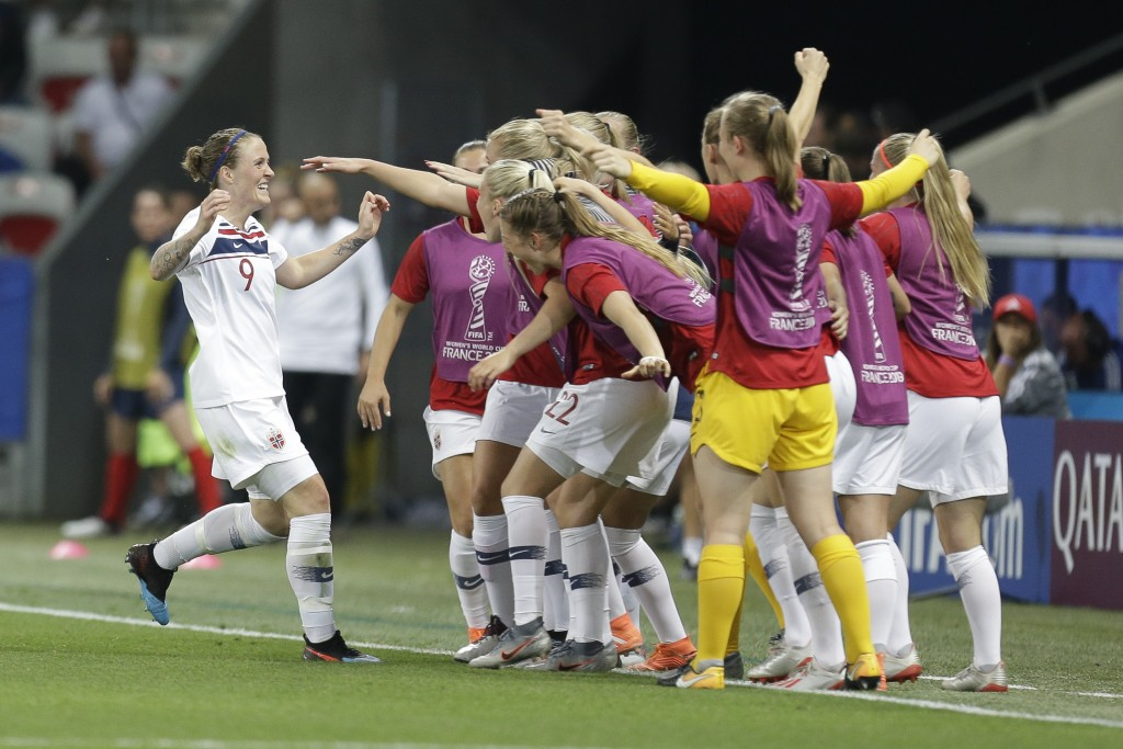 Norway's players celebrate after an own goal by France's Wendie Renard during the Women's World Cup Group A soccer match between France and Norway in ...