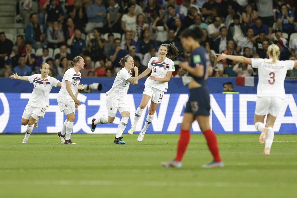 Norway's players celebrate after an own goal by France's Wendie Renard, foreground, during the Women's World Cup Group A soccer match between France a...
