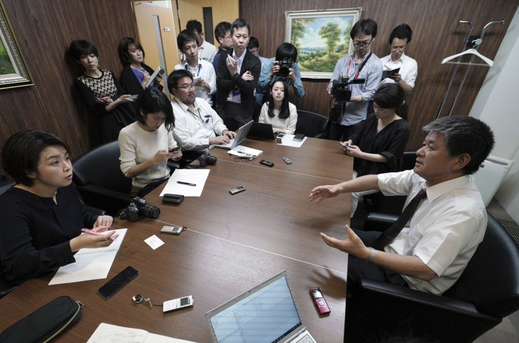 Michio Yube, right, director and general manager at the Kikuka Sankyo Co., LTD., speaks to media after one of their ships, the Kokuka Courageous, was
