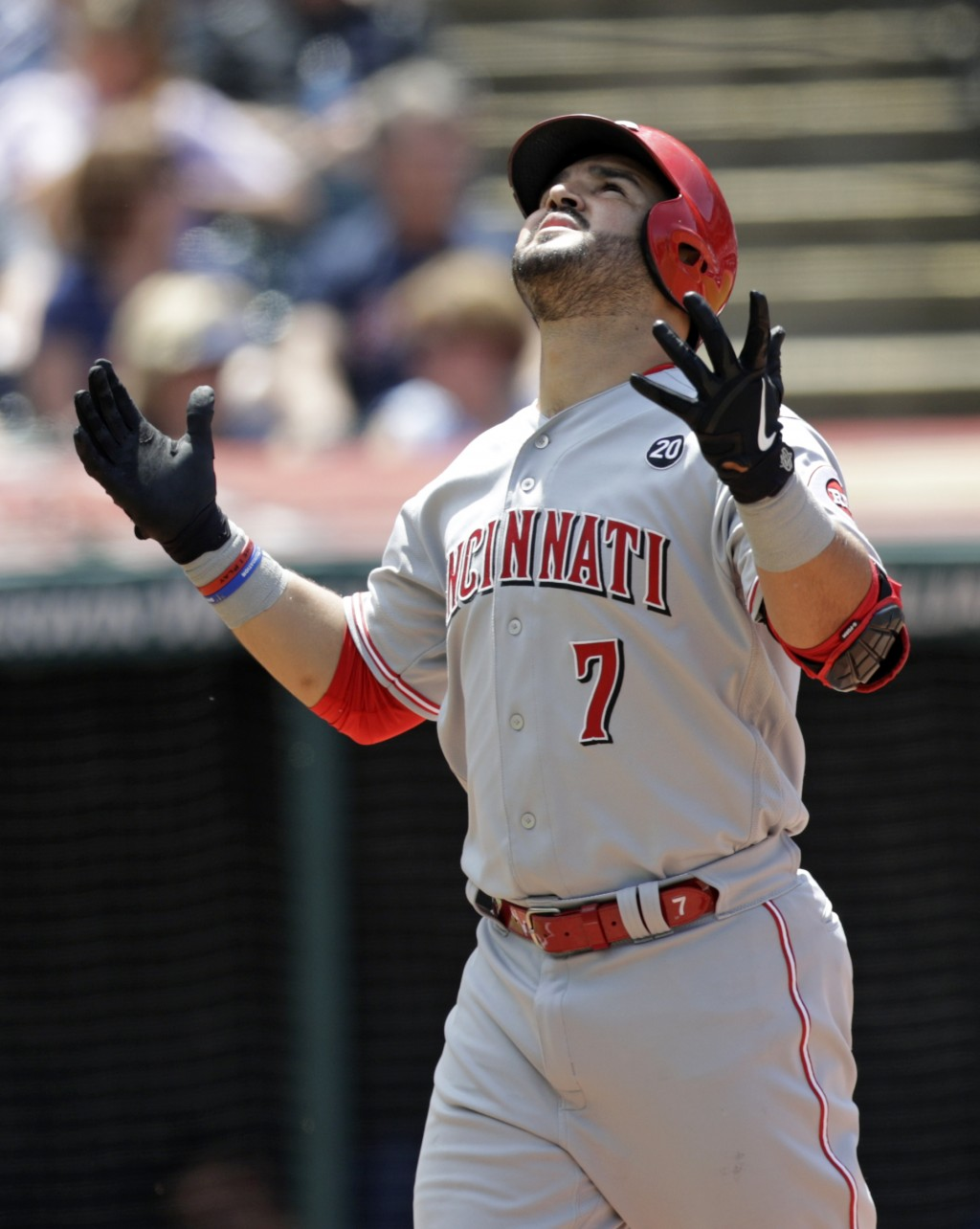 Cincinnati Reds' Eugenio Suarez looks up after hitting a solo home run in the sixth inning in a baseball game against the Cleveland Indians, Wednesday...