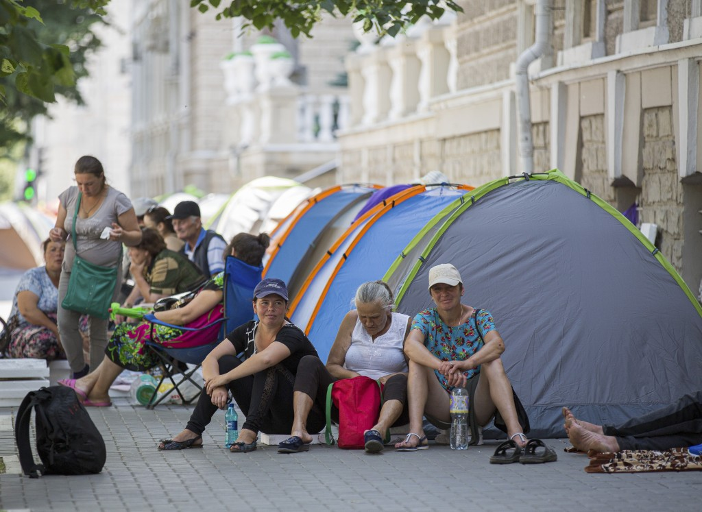 Supporters of the former government camp outside the interior ministry in Chisinau, Moldova, Wednesday, June 12, 2019. Moldova's police chief on Wedne