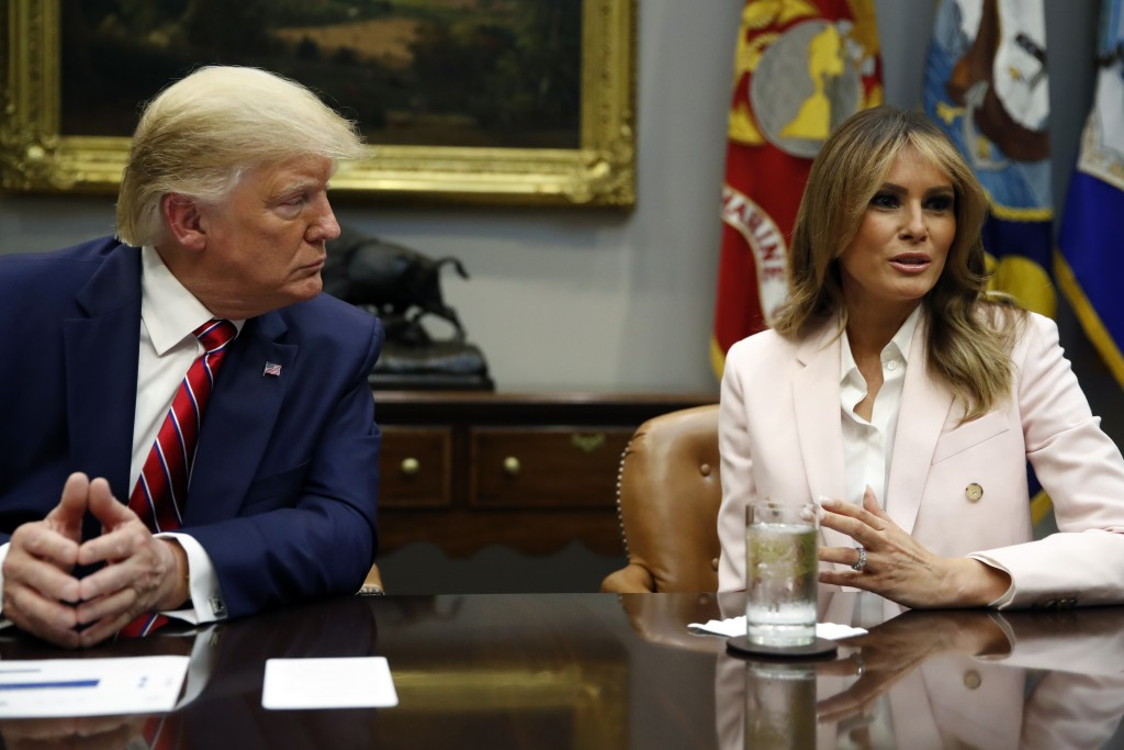 President Donald Trump listens as first lady Melania Trump speaks during a briefing on efforts to combat the opioid crisis in the Roosevelt Room of th