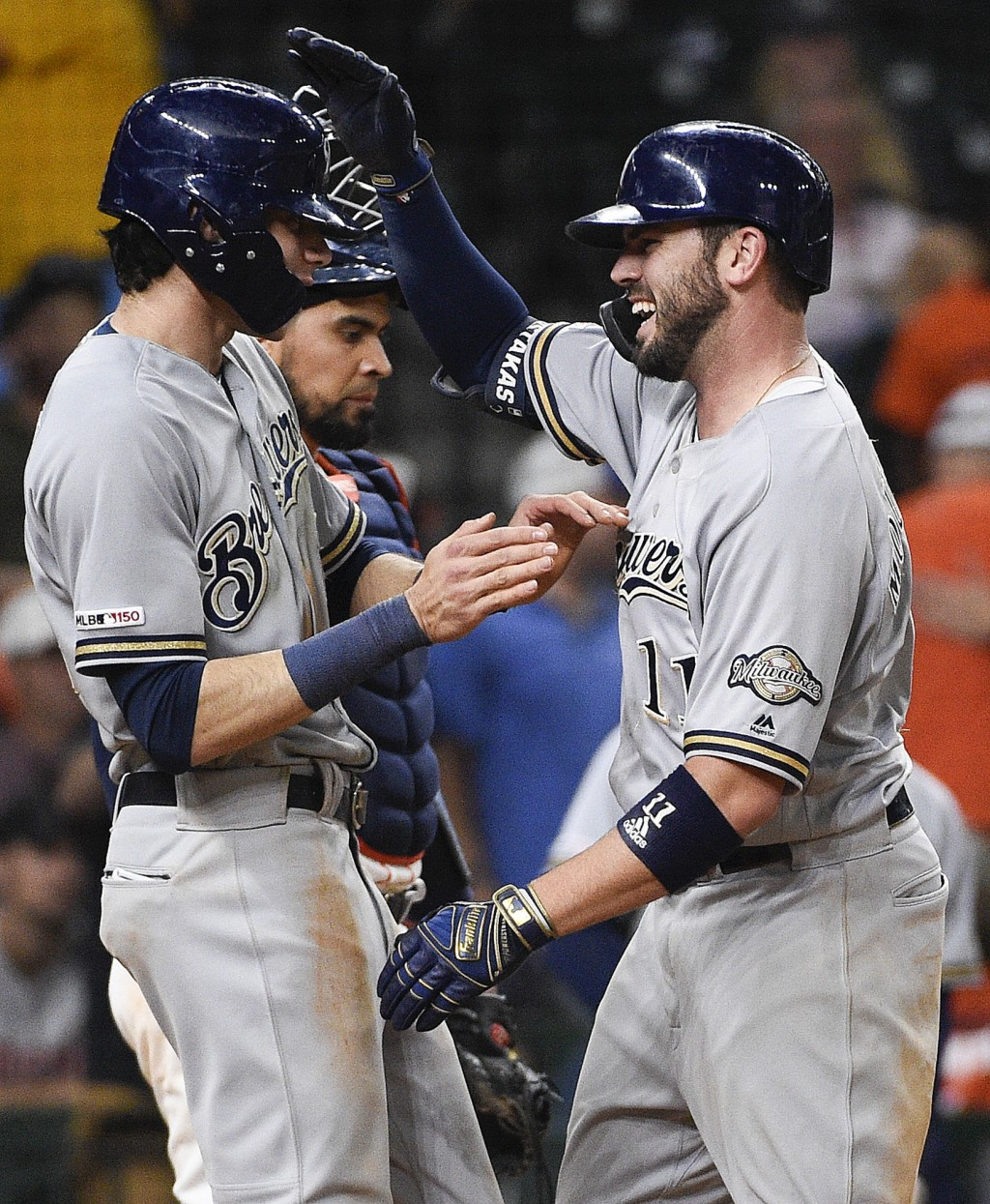 Milwaukee Brewers' Mike Moustakas, right, celebrates his two-run home run off Houston Astros relief pitcher Cionel Perez with Christian Yelich during