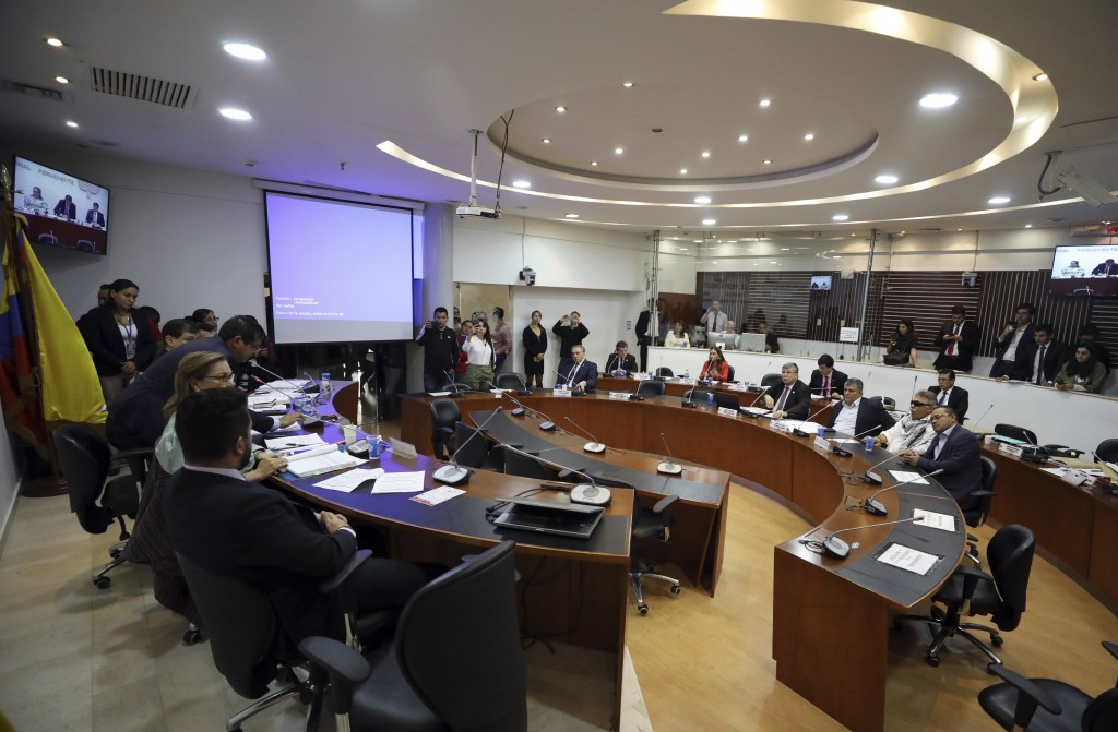 Former FARC rebel Jesus Santrich, second right down, attends a session of the Chamber of Representatives at the Colombian congress in Bogota, Colombia...