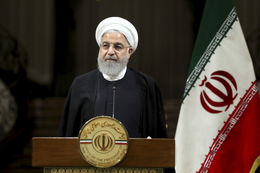 Iranian President Hassan Rouhani listens during a joint press conference with Japanese Prime Minister Shinzo Abe, after their meeting at the Saadabad