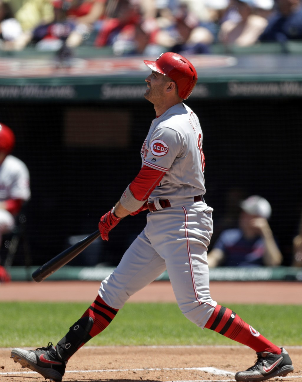 Cincinnati Reds' Joey Votto watches his ball after hitting a solo home run off Cleveland Indians starting pitcher Zach Plesac in the first inning in a...