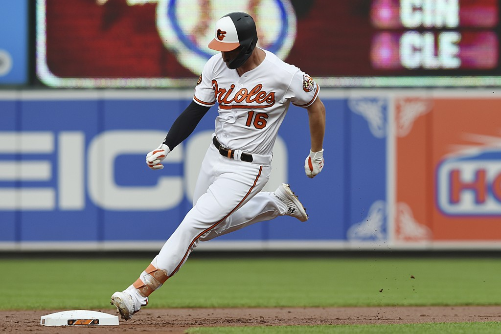 Baltimore Orioles' Trey Mancini rounds second on his way to a third on a triple against the Toronto Blue Jays during the first inning of a baseball ga...