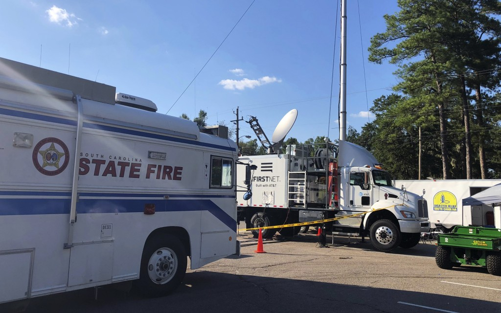 This Sept. 19, 2018, photo provided by AT&T shows equipment, center, that turns a satellite signal into an LTE cell tower that was used during Hurrica