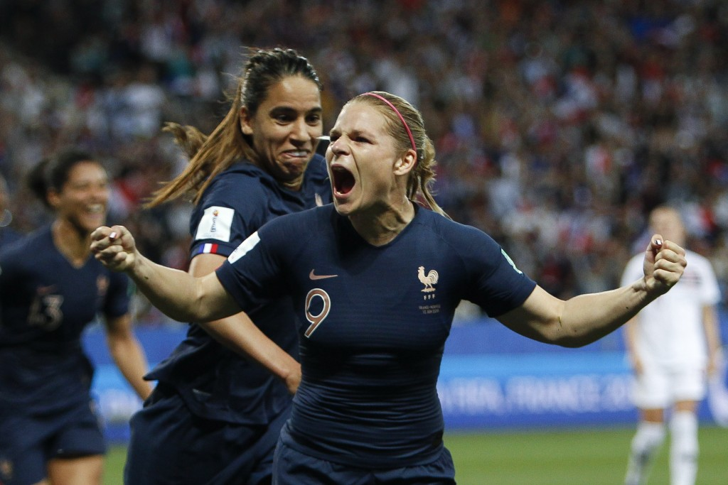 France's Eugenie Le Sommer, celebrates with France's Amel Majri after scoring her side's second goal on a penalty kick during the Women's World Cup Gr...