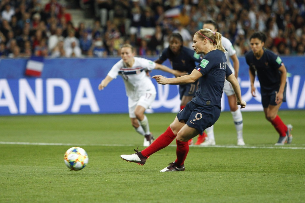 France's Eugenie Le Sommer scores her side's second goal on a penalty kick during the Women's World Cup Group A soccer match between France and Norway