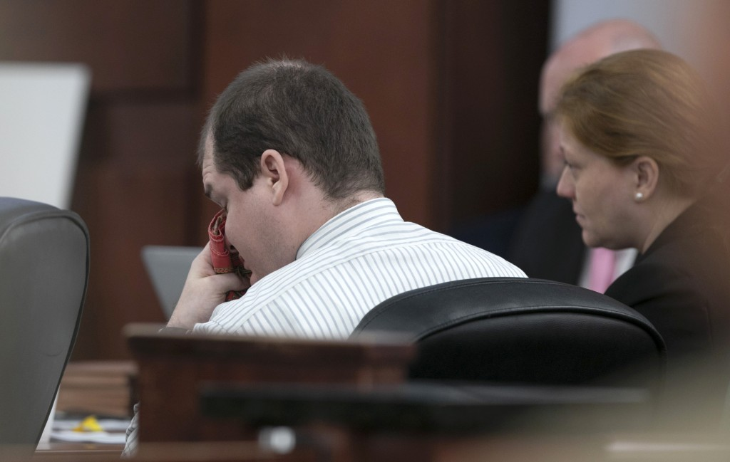 Tim Jones wipes his eyes as his family members testify during the sentencing phase of his trial in Lexington, S.C., Wednesday, June 12, 2019. Timothy