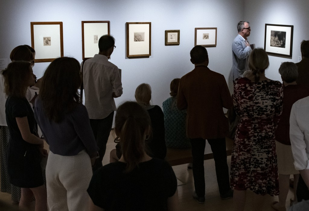 Journalists stand in one of the exhibition rooms during a press preview of the exhibition 'Rembrandt's Mark' in Dresden, eastern Germany, Thursday, Ju