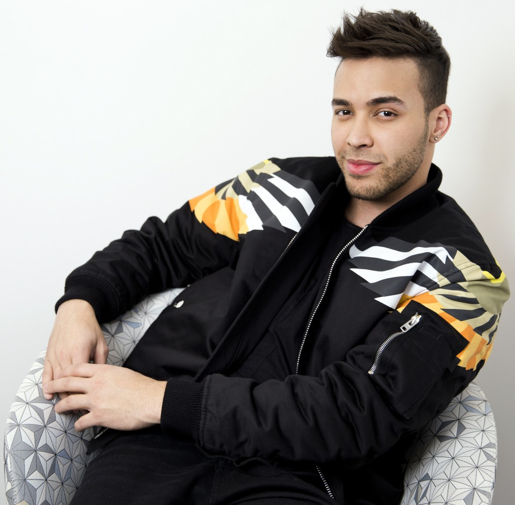 FILE - In this Monday, Feb. 27, 2017, file photo, singer Prince Royce poses for a portrait in New York. Royce says he's looking forward to headlining