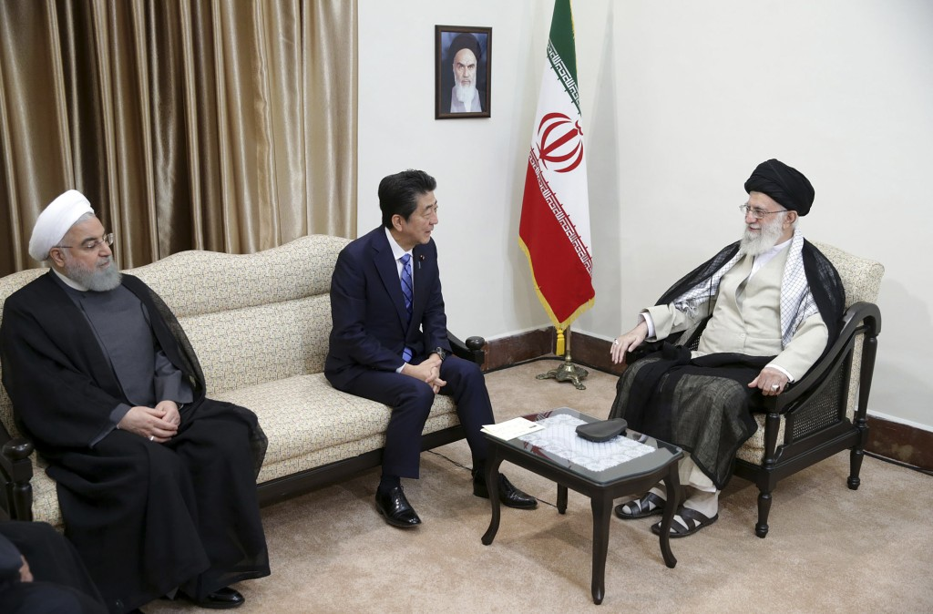 In this picture released by the official website of the office of the Iranian supreme leader, Supreme Leader Ayatollah Ali Khamenei, right, meets with