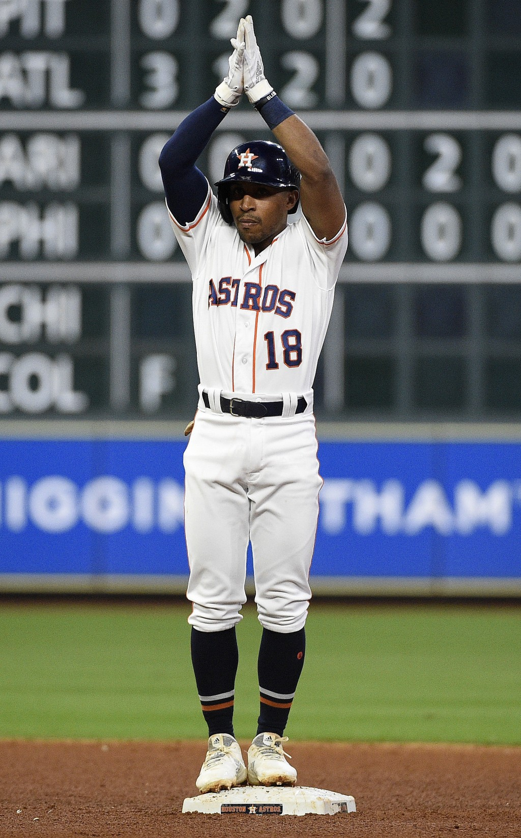 Houston Astros' Tony Kemp reacts after hitting a t...