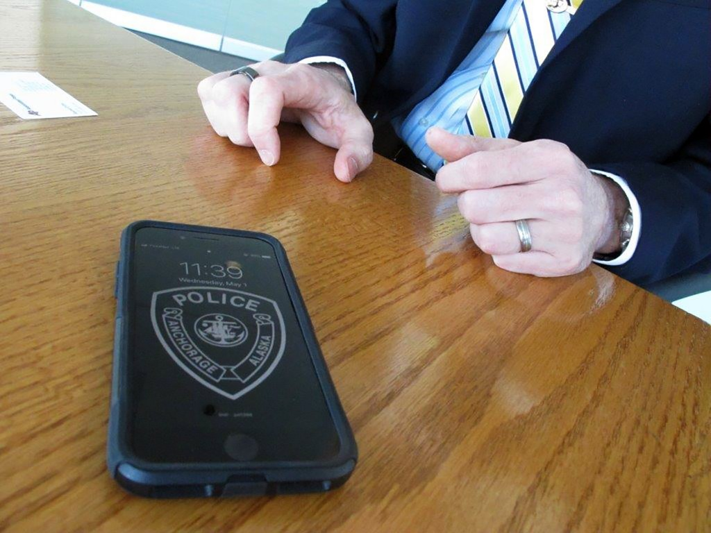 In this Wednesday, May 1, 2019, photo, Anchorage Police Chief Justin Doll shows his phone, which is tapped into a new national wireless network dedica