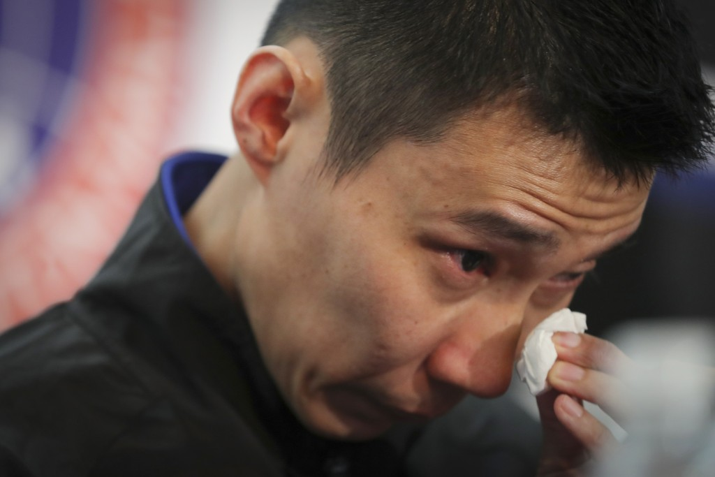Malaysian badminton player Lee Chong Wei wipes his tears during a press conference in Putrajaya, Malaysia, Thursday, June 13, 2019. Former World No. 1