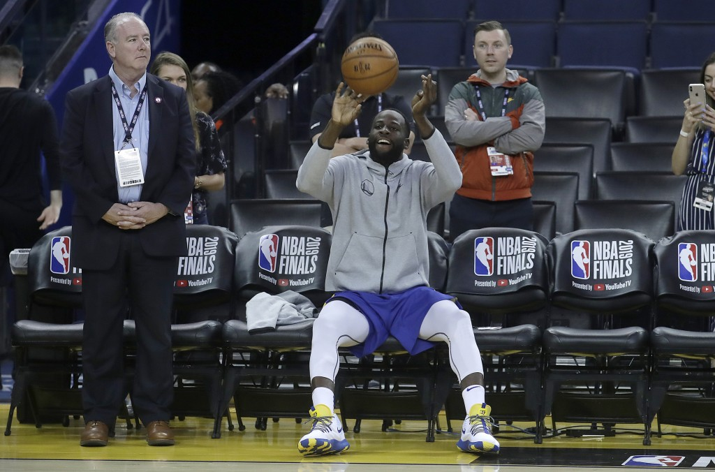 Golden State Warriors forward Draymond Green shoots from the bench during a team practice in Oakland, Calif., Wednesday, June 12, 2019. The Warriors a