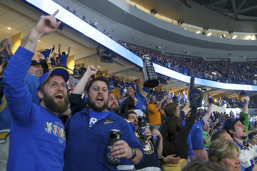 St. Louis Blues fans react during the final minutes of Game 7 of the team's NHL hockey Stanley Cup Final against the Boston Bruins in Boston, as they ...