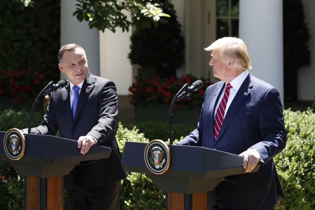 President Donald Trump and Polish President Andrzej Duda attend a news conference in the Rose Garden of the White House, Wednesday, June 12, 2019, in ...