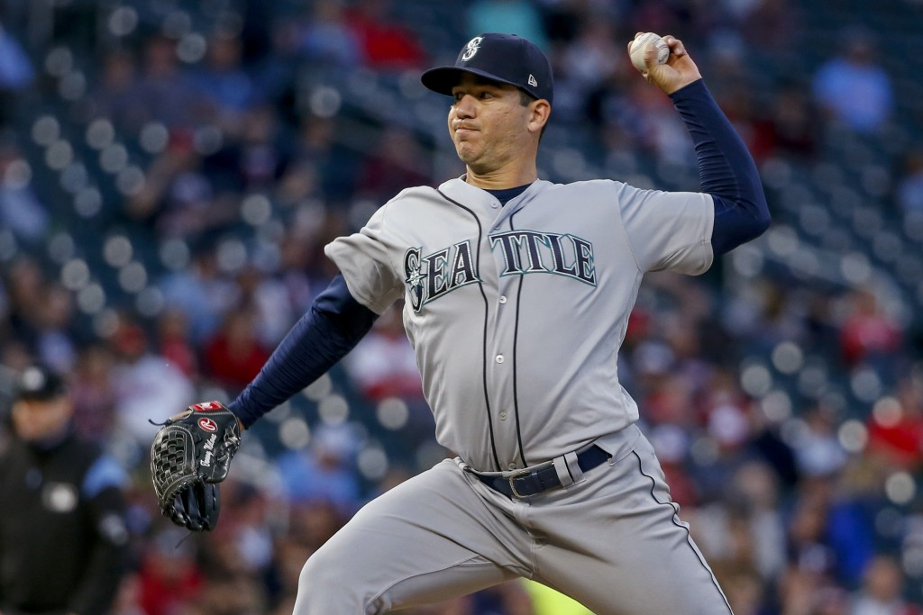 Seattle Mariners pitcher Tommy Milone throws to a Minnesota Twins batter during the fifth inning of a baseball game Wednesday, June 12, 2019, in Minne