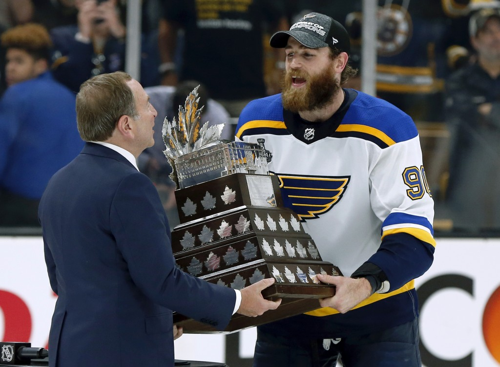 NHL Commissioner Gary Bettman presentes St. Louis Blues' Ryan O'Reilly with the Conn Smythe trophy after the Blues' win over the Boston Bruins in Game...