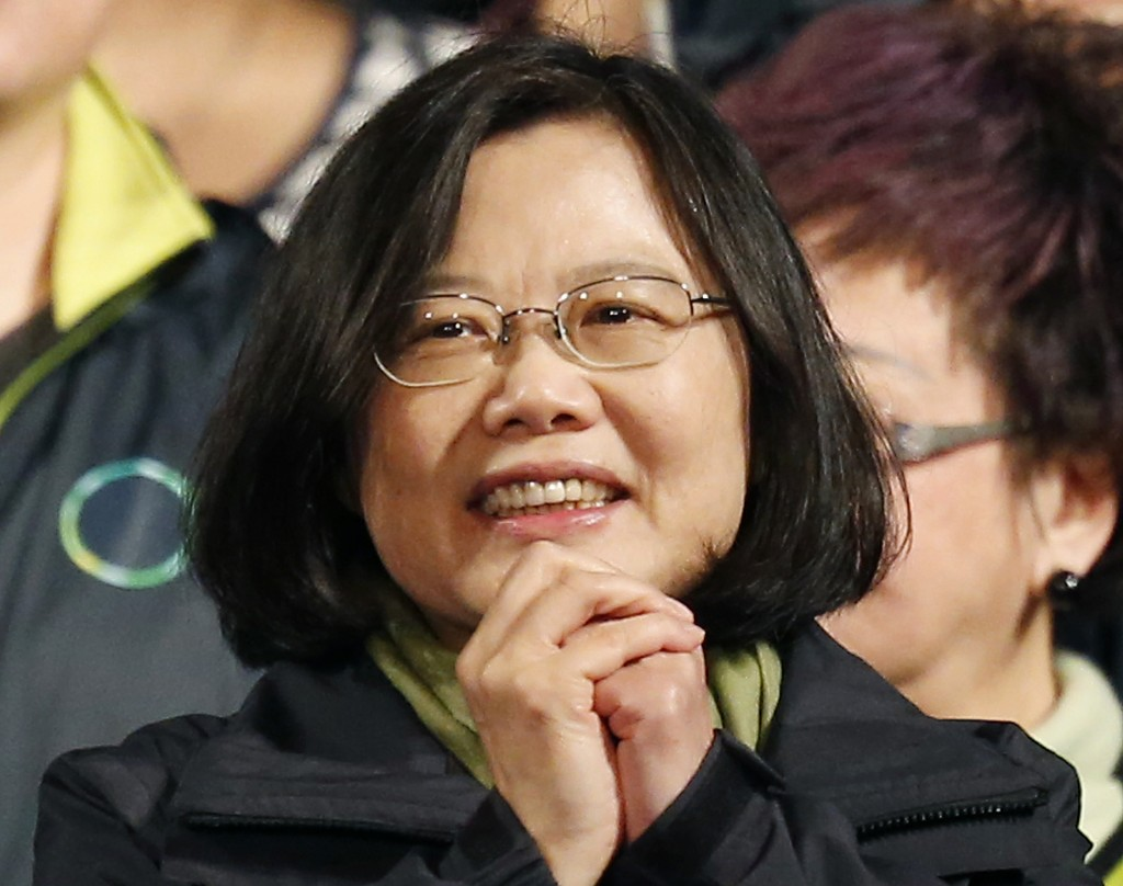 FILE - In this Jan. 16, 2016, file photo, Taiwan's Democratic Progressive Party, DPP, presidential candidate Tsai Ing-wen thanks supporters as she cel