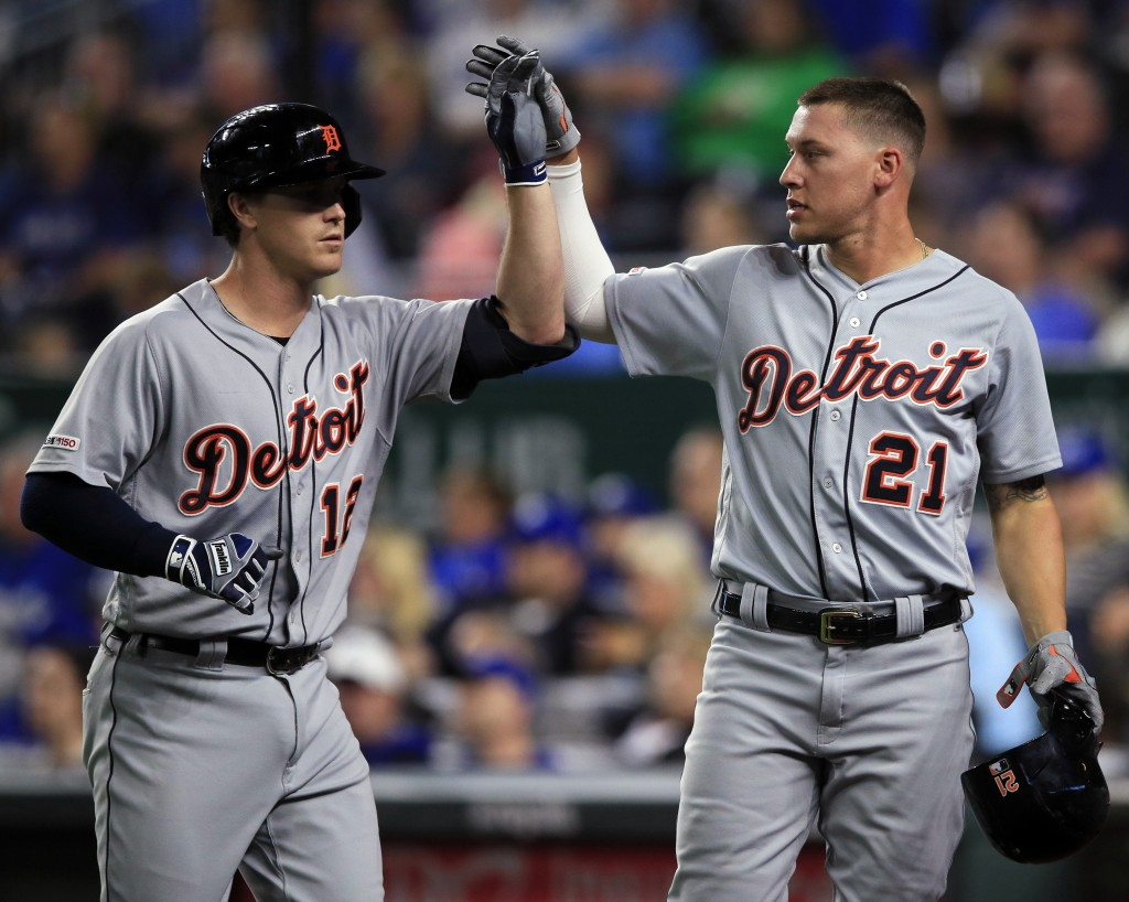 Detroit Tigers' Brandon Dixon (12) and JaCoby Jones (21) celebrate during the eighth inning of the team's baseball game against the Kansas City Royals...