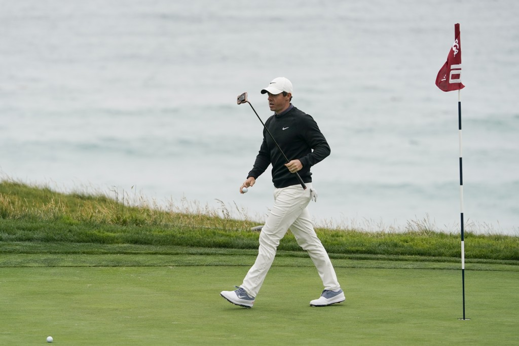 Rory McIlroy, of Northern Ireland, walks across the 10th green during a practice round for the U.S. Open Championship golf tournament Wednesday, June ...