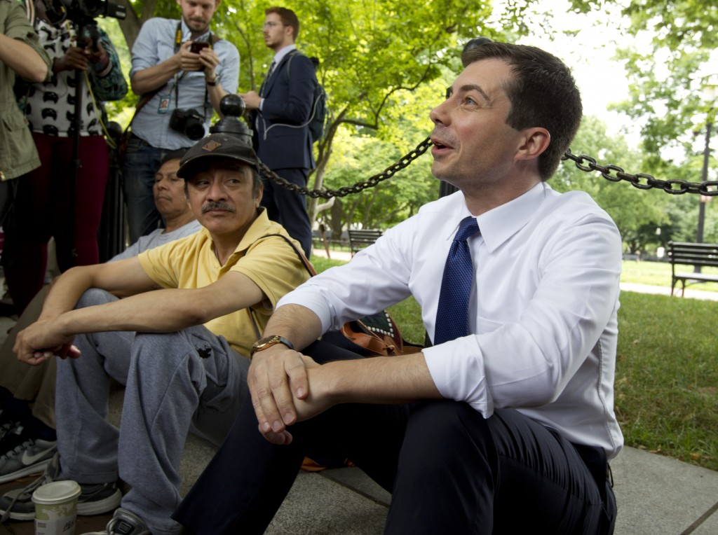 Democratic presidential candidate Mayor Pete Buttigieg, right, attends a rally protesting against President Donald Trump policies outside of the White