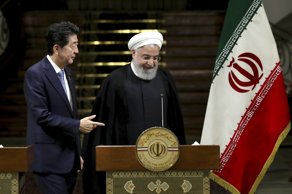 Japanese Prime Minister Shinzo Abe, left, and Iranian President Hassan Rouhani, attend a joint press conference after their meeting at the Saadabad Pa...