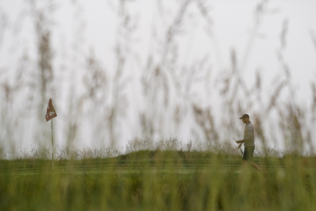 Martin Kaymer, of Germany, walks on the fourth green during a practice round for the U.S. Open Championship golf tournament, Wednesday, June 12, 2019,