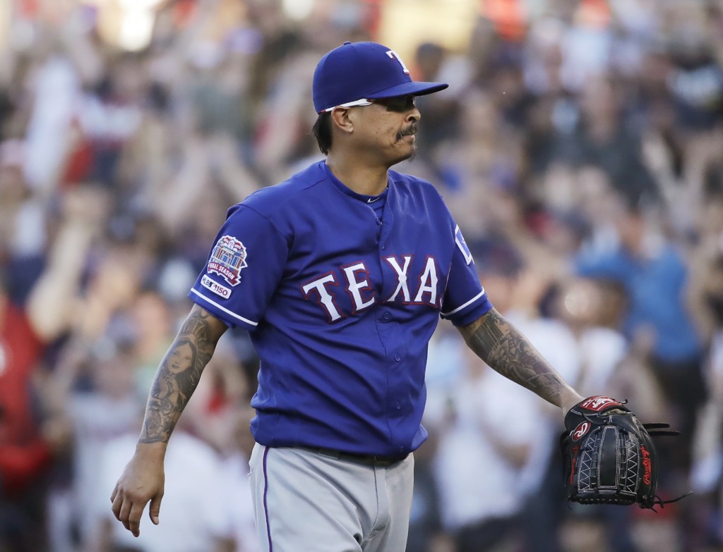 Texas Rangers relief pitcher Jesse Chavez leaves the mound after giving up walk to Boston Red Sox's Mookie Betts that drove in the winning run in a ba...