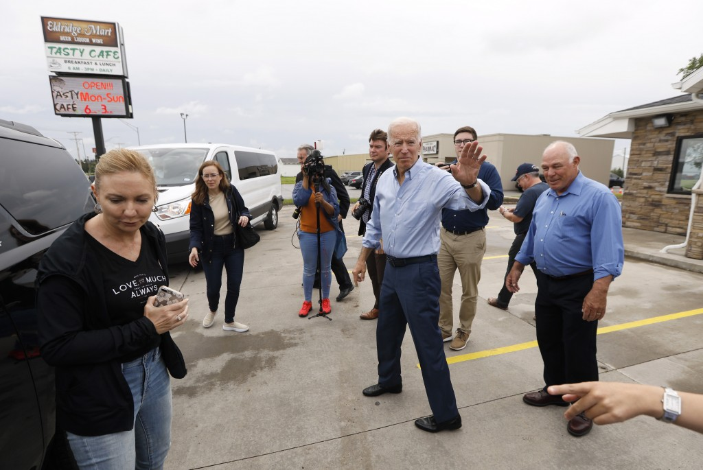 Democratic presidential candidate former Vice President Joe Biden waves to local residents after a stop at the Tasty Cafe, Wednesday, June 12, 2019, i