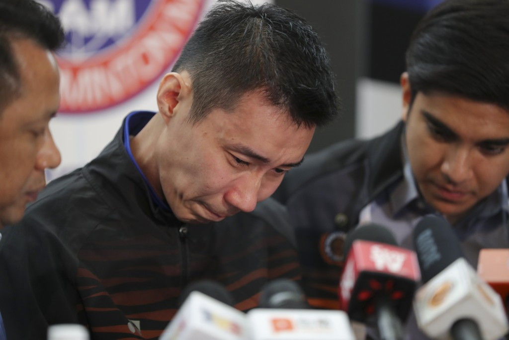 Malaysian badminton player Lee Chong Wei, center, cries during a press conference in Putrajaya, Malaysia, Thursday, June 13, 2019. Former World No. 1-