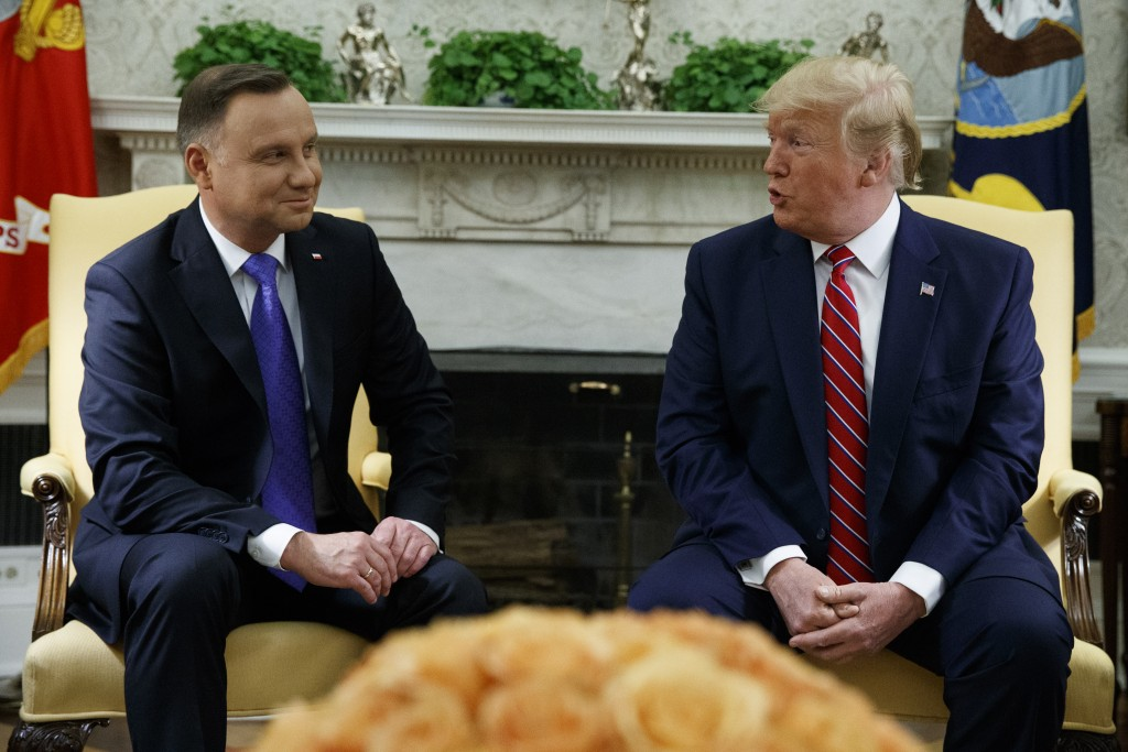 President Donald Trump meets with Polish President Andrzej Duda in the Oval Office of the White House, Wednesday, June 12, 2019, in Washington. (AP Ph...