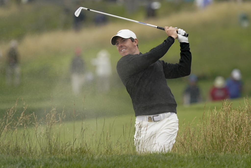 Rory McIlroy, of Northern Ireland, hits out of the bunker on the 10th hole during a practice round for the U.S. Open Championship golf tournament Wedn...