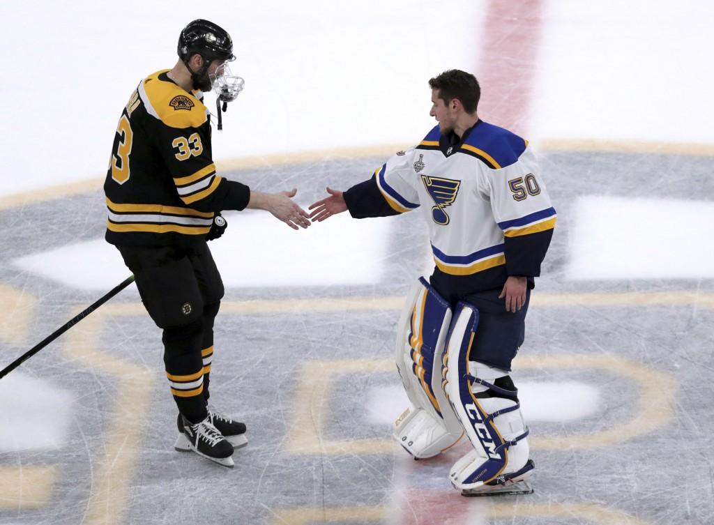 Boston Bruins' Zdeno Chara, left, of Slovakia, congratulates St. Louis Blues goaltender Jordan Binnington for the Blues' win over the Bruins in Game 7